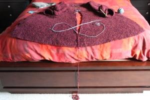 Placing cut edges on waste yarn