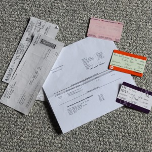 2 airline boarding passes, a train to Birchington, London tube pass, and a Heathrow Express ticket, plus hotel