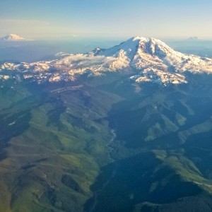 Volcanos of Washington State taken from the window of the airplane