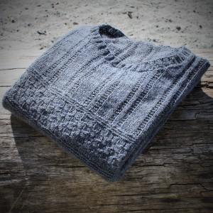 The Skye sweater sitting on driftwood