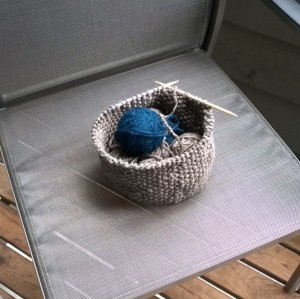 Knit basket. It's nice when a project holds its own materials!
