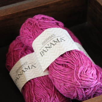 Bernat Panama in fuchsia -- I've got over 1800 yards of the stuff