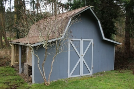 The old shed, now free of moss and missing it's weathervane